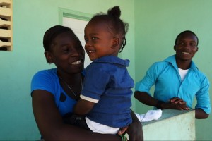A smiling family receives their new home in Boca Grande Friendship Village V in Gressier, Haiti. Dedicated on Jan.13, 2016, the village was built  by Boca Grande's Hope For Haitians Committee through the international and relief organization Food For The Poor. The village is the committee's fifth Friendship Village and marks the completion of 200 homes built by Boca Grande.