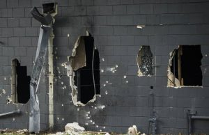 Breaching hole where hostages escaped after BearCat rammed the wall