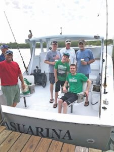 Young pilot visits family in Boca Grande, fishes for tarpon for the first time