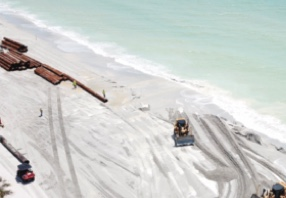 Beach renourishment moving along – Never mind the occasional pink water