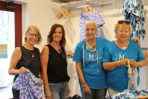Local business buys 800 pieces of clothing for charity organization